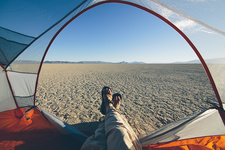 Man in camping tent in the desert, Nevada, USA