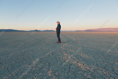 Man standing in the desert, Nevada, USA