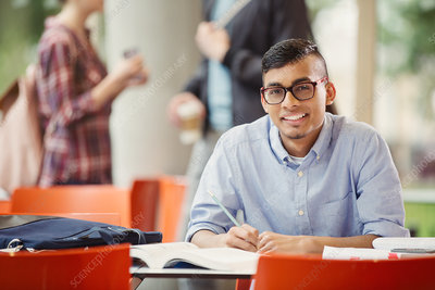 Portrait male college student studying