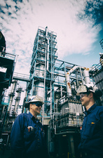 Two industrial workers on oil and gas refinery