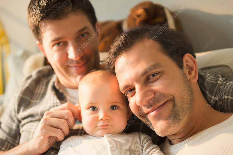 Portrait smiling male gay parents and baby son