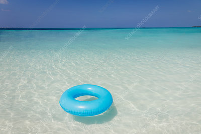 Blue inflatable ring floating