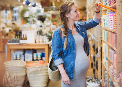 Pregnant woman shopping for candles