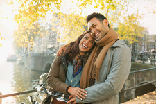 Laughing young couple hugging