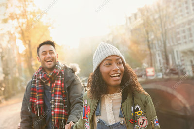 Laughing young couple walking