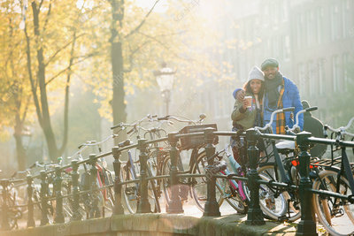Young couple drinking coffee along bicycles