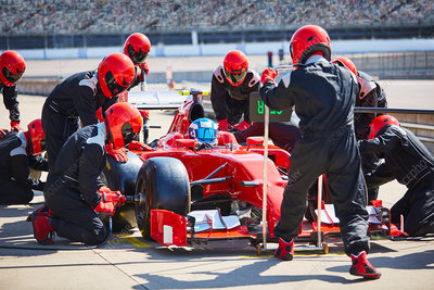 Pit crew working on formula one race car