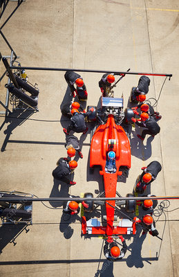 Overhead pit crew working on formula one race car