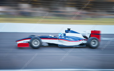 Side view formula one race car on sports track