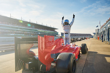 Formula one race car driver cheering