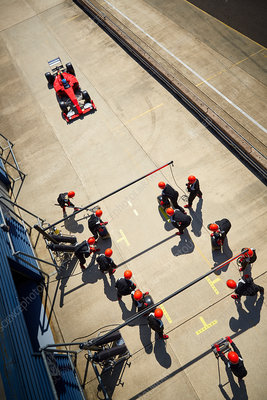 Pit crew ready for nearing formula one race car