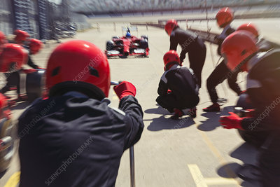 Pit crew ready for nearing race car driver