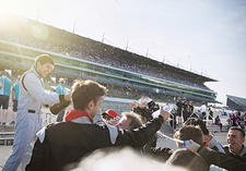 Racing team and driver spraying champagne
