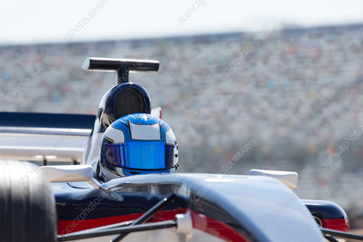 Formula one race car driver wearing helmet