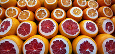 Red grapefruit, cross sections, packed together