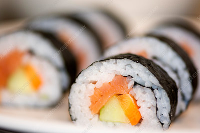 A dish of sushi, seaweed rolls and fish