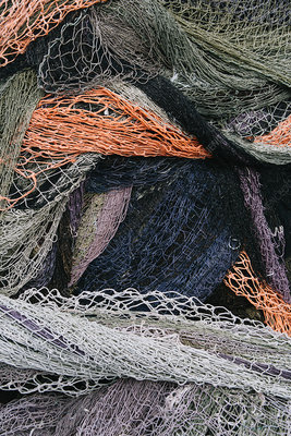 Close up of a pile of tangled up commercial fishing nets