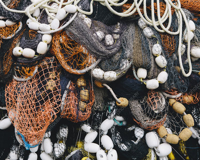 Tangled up commercial fishing nets with floats attached