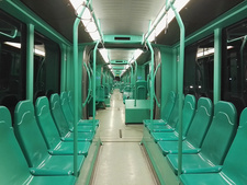 Interior view of a tram with bright green seats