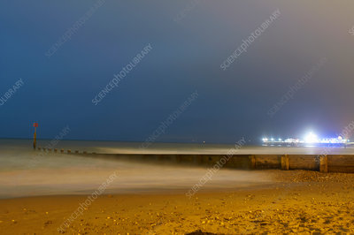 Waves rolling in on beach at night