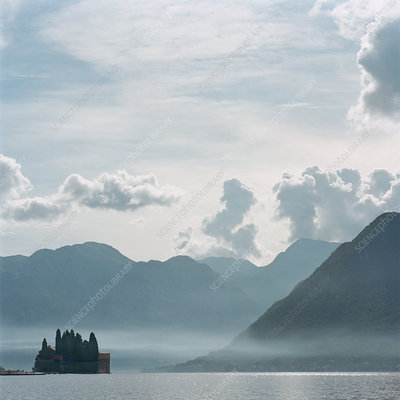 Castle and mountaintops on water
