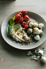 Plate of quail eggs dukkha with tomatoes