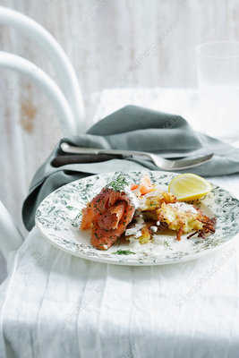 Plate of rosti with vodka salmon