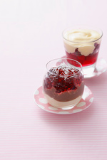 Glass of berry jam with cream
