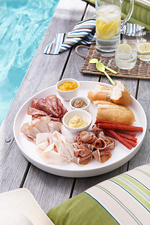 Plate of sliced meats, bread and mustard