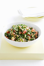 Bowl of tabouleh with herbs and tomatoes