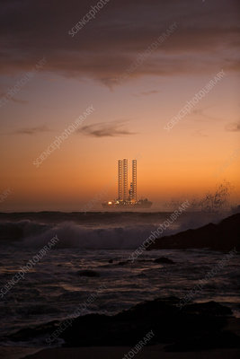 Sunset over off coast oil rig