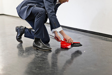 Businessman sweeping office floor