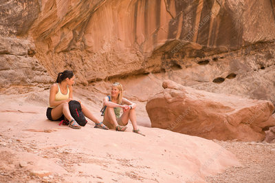 Rock climbers relaxing on boulder