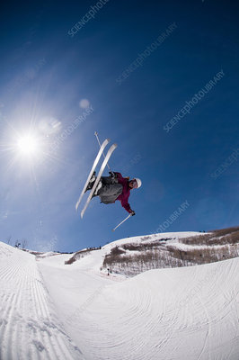 Skier jumping on snowy slope