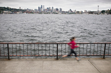Blurred view of runner by waterfront