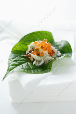 Caviar and fish in leaf