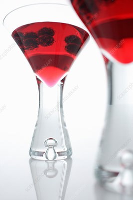 Glasses of juice with berries