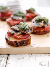Toast with tomatoes, meat and herbs