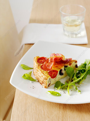Plate of quiche with tomatoes