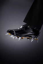 Businessman wearing spikes on shoe