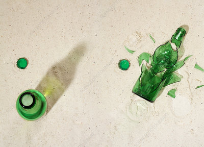 Broken beer bottles in sand