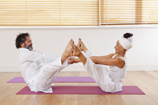Couple practicing yoga in class