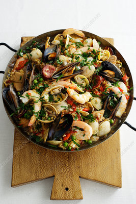 Pan of paella on wooden board