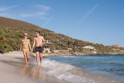 Couple walking together on beach