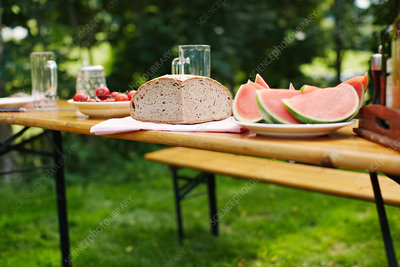 Fruit and bread on table outdoors