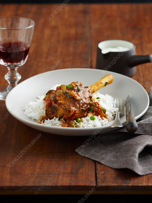 Plate of lamb, peas and rice