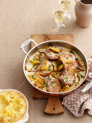 Dish of pork cutlets and apples