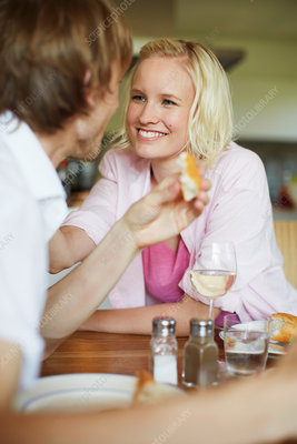 Couple smiling together at dinner