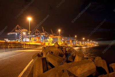 Cranes and containers in shipyard