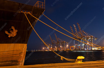 Ship docked in shipyard at night